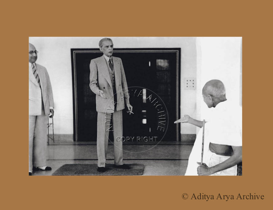 Mahatma Gandhi meeting M.A.  Jinnah at his Delhi residence. Also seen is Shaukat Ali.Undated