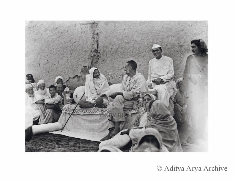 Mahatma Gandhi with  Khan Abdul Ghaffar Khan at his native village Utmanzai, seen behind is Mahadeo Desai. 1938