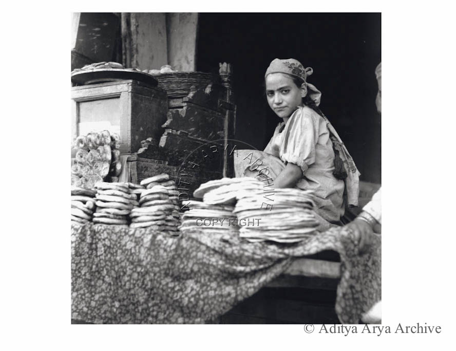A young Kashmiri girl selling the local bread.1950s