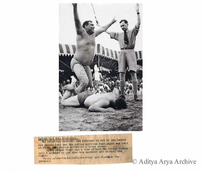 Lahore war Fund Wrestling. The wrestling carnival was arranged in aid of the Lahore war planes fund and the Police spitfire fund, which was held at Minto Park, Lahore attracted a large crowd. Daula Clark fight was a tame affair. The Indian taking only 3 minutes to pin down his opponent and winning the fight. Photo shows: Daula (left, standing) and Clark &(on the ground).