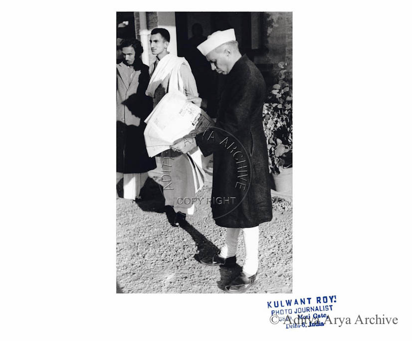 Jawaharlal Nehru scanning the Headlines. Undated