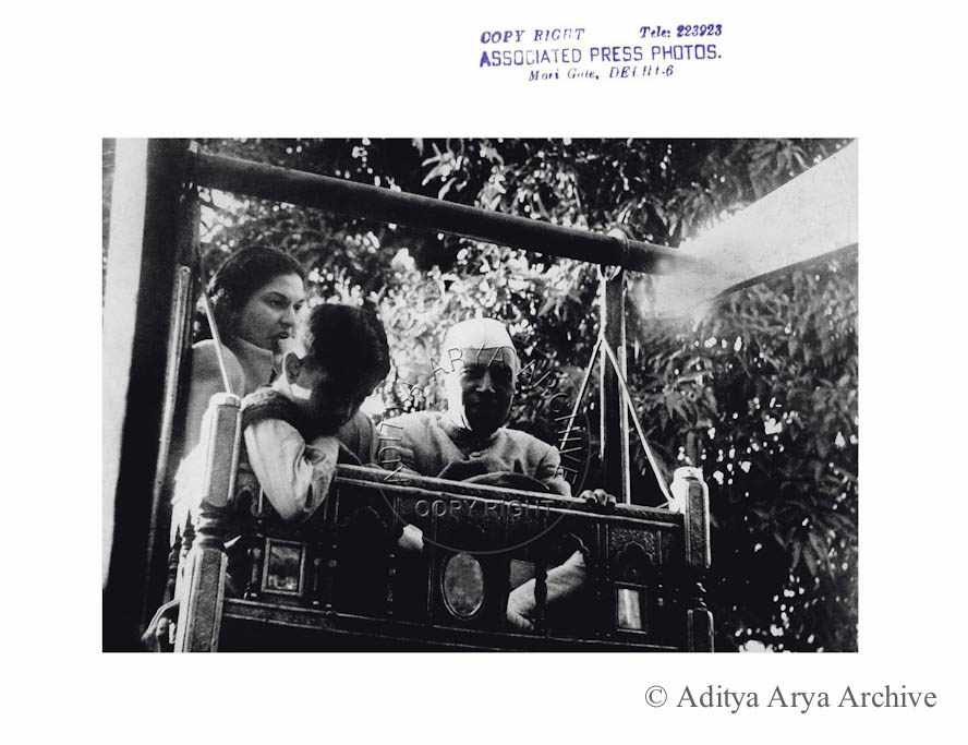 Jawaharlal Nehru on a merry –go-round with Rajiv and niece Chandralekha.1948