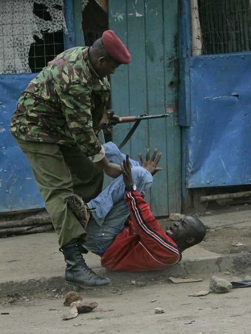 A police officer beat a opposition supporter, Thursday, Jan. 17, 2008 during riots in the Mathare slum in Nairobi.