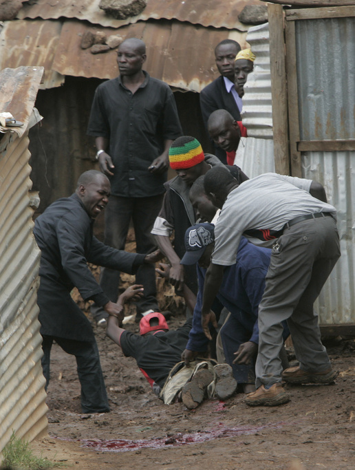 Opposition supporters help a fellow supporter moments after he was shot, Friday, Jan. 18, 2008 during clashes between the police and opposition supporters in the Kibera slum in Nairobi.
