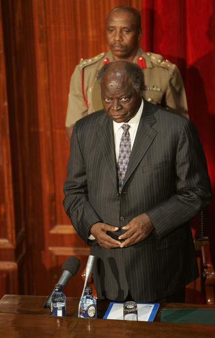 "Kenyan President Mwai Kibaki observe a minute of silence for victims of violence, Tuesday, Jan. 29, 2008 during the opening of the ""dialogue process,"" in Nairobi"