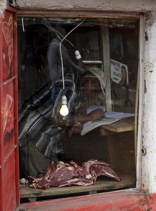 A man work in a butcher shop,Wednesday, May 27, 2009 in the Kibera slum in Nairobi, Kenya.Kibera in Nairobi, Kenya is the largest slum in Africa, and has a population estimated at one million.