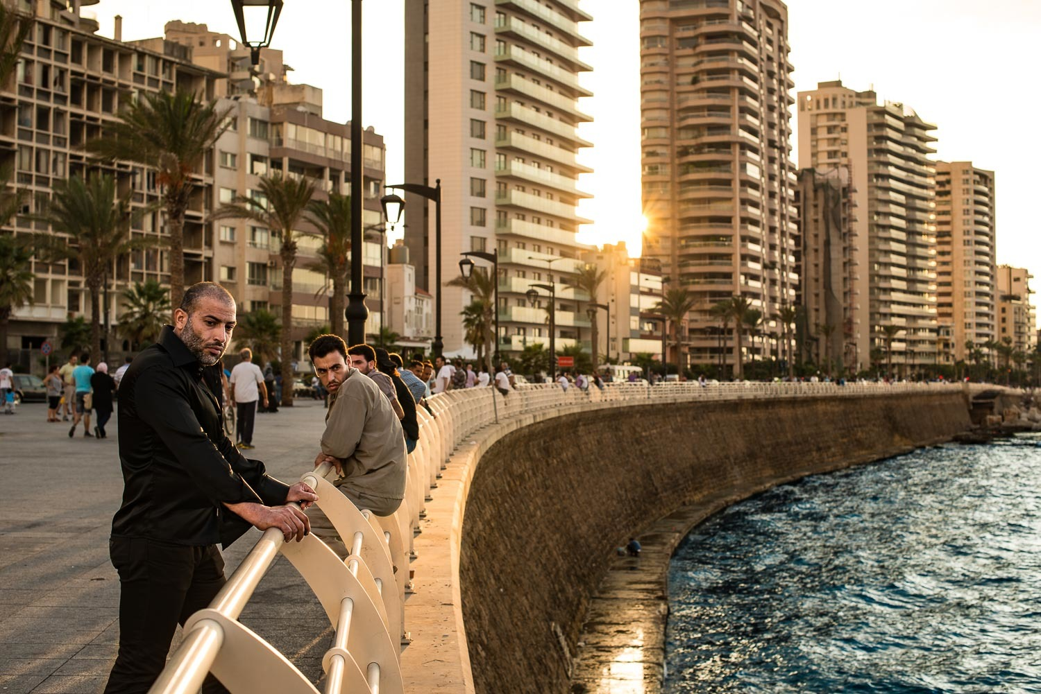 Men contemplate the Mediterranean Sea from the Corniche, Beirut. During the first two years of the Syrian civil war, Lebanon had mostly remained untouched by the conflict raging in its neighbor country. However, a wave of car bombs changed that scenario.