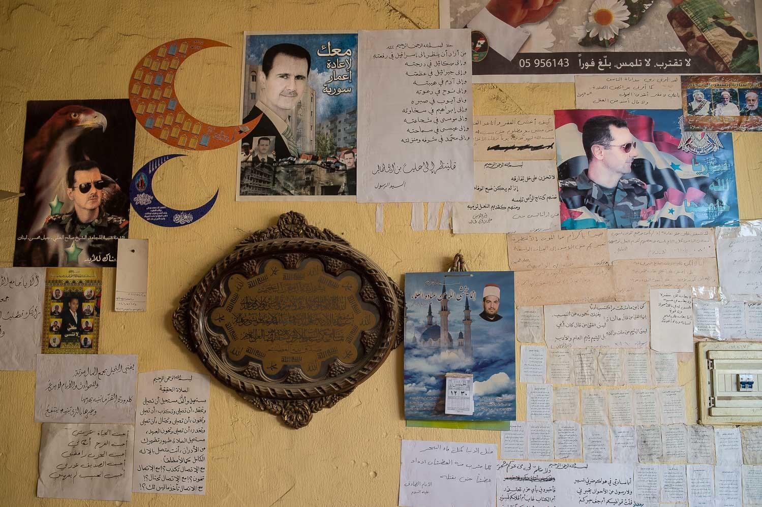 Posters of Bashar al Assad decorate the wall of a local coffee house in the Jabal Mohsen neighborhood, Tripoli. Most of the community supports Assad, however it's very uncommon to find someone approving his violent methods.