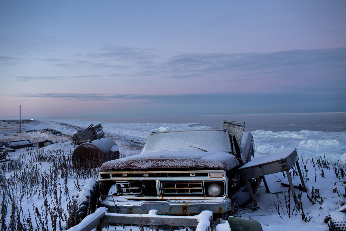 An abandoned vehicle, one of many scattered around the village. Only the school and one resident have functional vehicles on the Island. Shishmaref is a barrier island with a population of less than 600 Alaska native Inupiaq people located 30 miles south of the Arctic Circle. The island is threatened by global temperature rises which have disproportionately affected the Arctic. Rising water levels and increased erosion mean that Shishmaref is slowly being absorbed by the surrounding seas and the prognosis is that it will disappear completely over the next two decades.