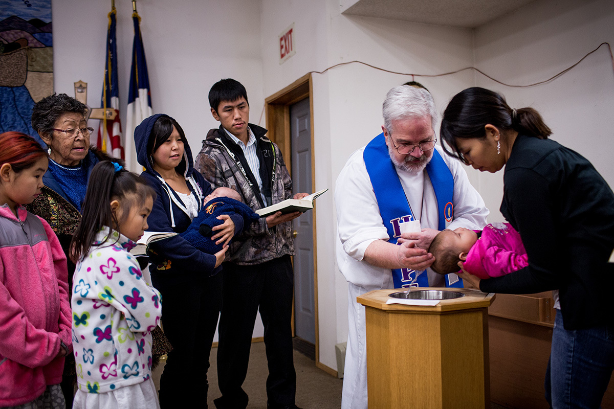 Pastor Marvin Jonasen baptises a child at the Shishmaref Lutheran Church, the only church in the town. Shishmaref is a barrier island with a population of less than 600 Alaska native Inupiaq people located 30 miles south of the Arctic Circle. The island is threatened by global temperature rises which have disproportionately affected the Arctic. Rising water levels and increased erosion mean that Shishmaref is slowly being absorbed by the surrounding seas and the prognosis is that it will disappear completely over the next two decades.