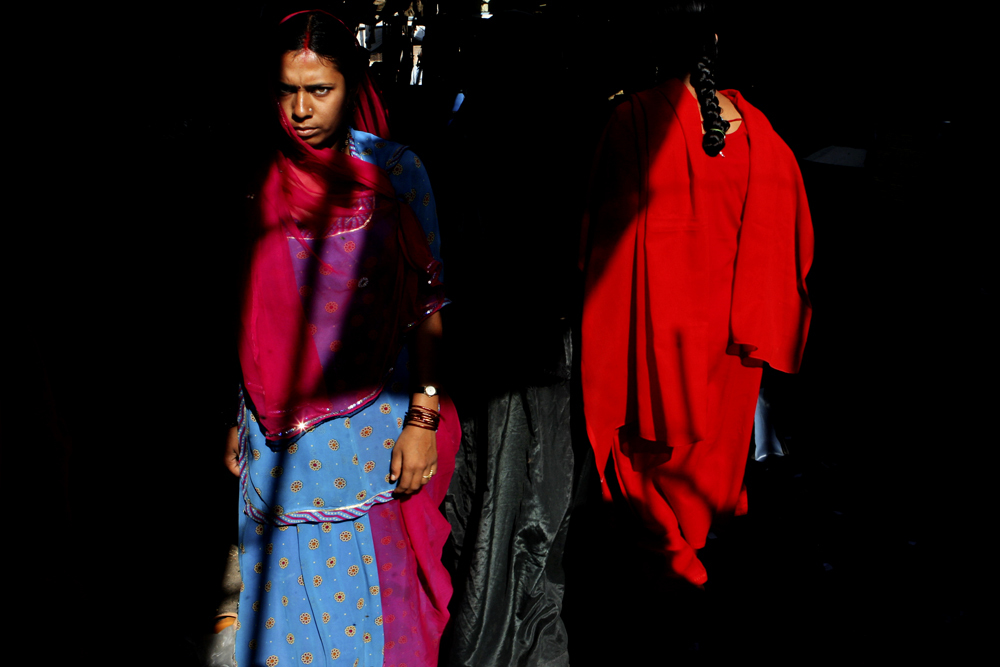 A woman walks down an alley in morning light, Jodhpur, Rajasthan. On March, 18, 2008.