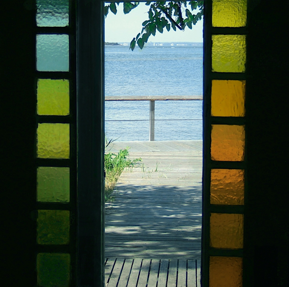 Bay Bracketed By Stained Glass Door