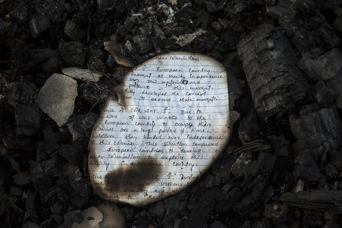 A handwritten piece of paper from one of the burnt Bodo homes which supposedly gave shelter to NDFB(S) militants in Biswanath Chariali.