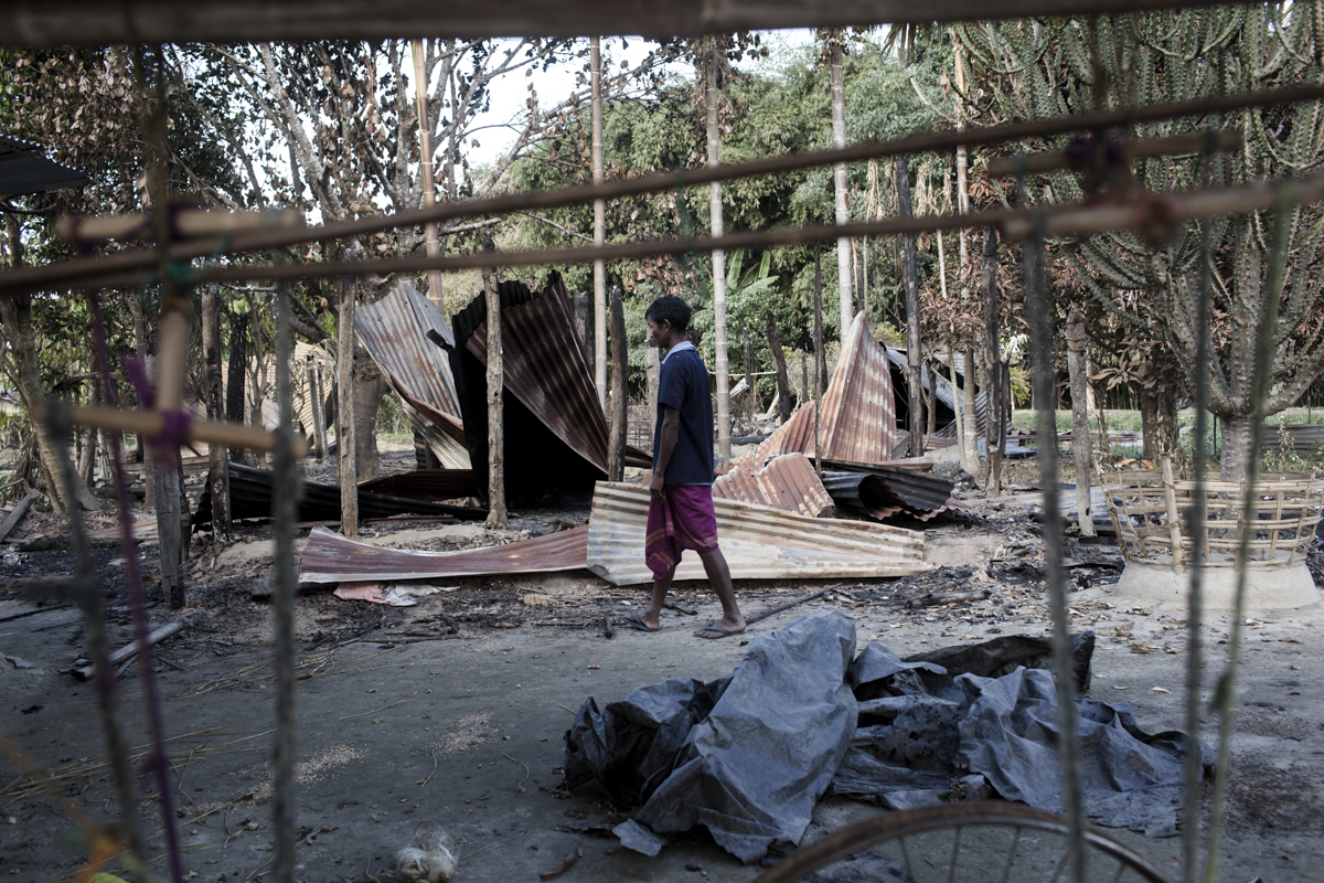Umesh Daimary, a weaver, at his burnt home in Kokrajhar. On December 24, the villagers saw adivasis armed with bows and arrows 300 metres away and ran into the forest, where they remain. They come back during the day to look after their fields. There is no army presence in the area and they are afraid to resettle in the village