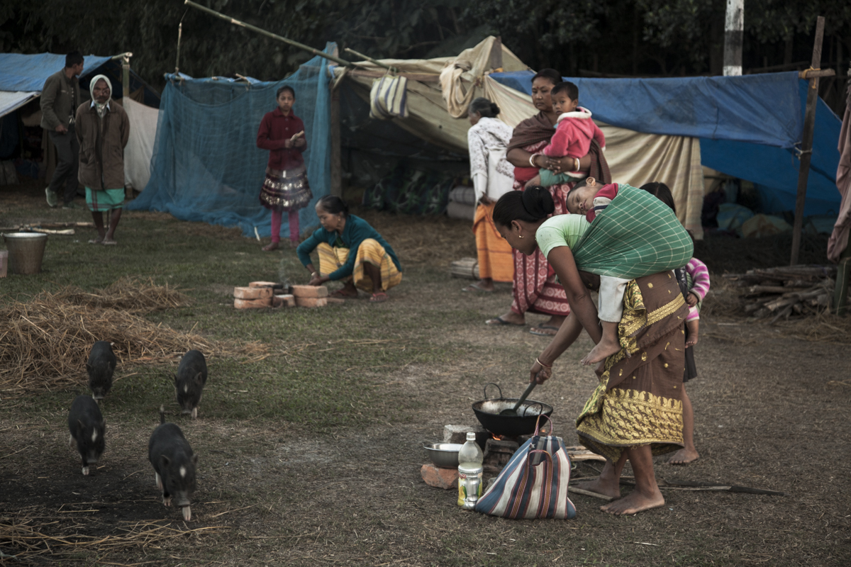 Bodo Women at Jambuguri relief camp, Kokrajhar, cook supper
