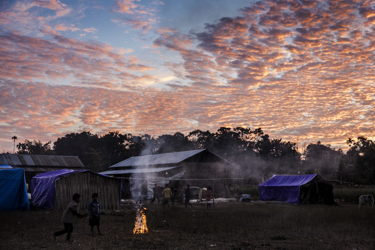 Bodo children play volleyball at dusk at the Jambuguri relief camp in Kokrajhar.