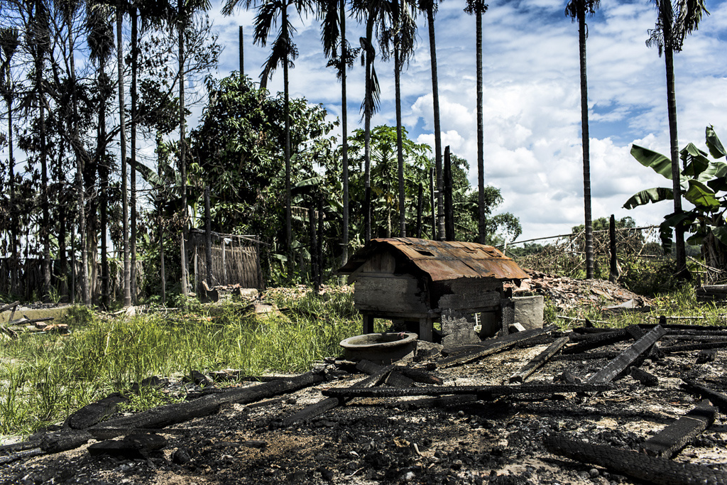 In July-Aug, 2012, Bodoland Territorial Autonomous District (BTAD, Assam) went up in flames with ethnic violence between the Indigenous Native Bodos and the immigrant Bengali Muslims. A burnt home in Pachimdeulgari village, Chirang District where all 65 houses were burnt and one resident hacked to death in the dark of the night. The villagers reported of hearing gunshots and firing before fleeing their village.