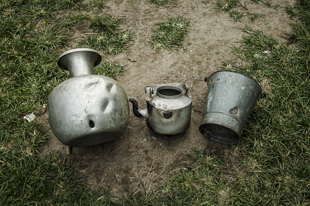 Utensils with bullet holes at Bengtol Hr. Sec. School refugee relief camp that house 1549 bengali muslim. Before firing at the houses, the miscreants fired few rounds in the air and then targeted the cattle around 8.30am on 26th July, 2012.