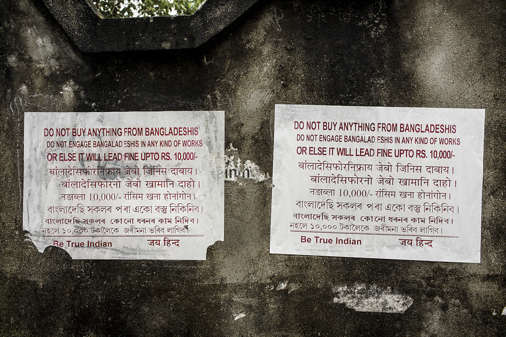 "a poster outside Gambaribeel relief camp in Gossaigaon forbids locals and refugees from buying anything from Bangladeshi Muslims and threatens a stiff penalty as punishment. Similar posters, asking people to not give shelter to ""illegal immigrants"", were seen pasted on the walls of educational institutions in Jorhat in October 2012 as well."