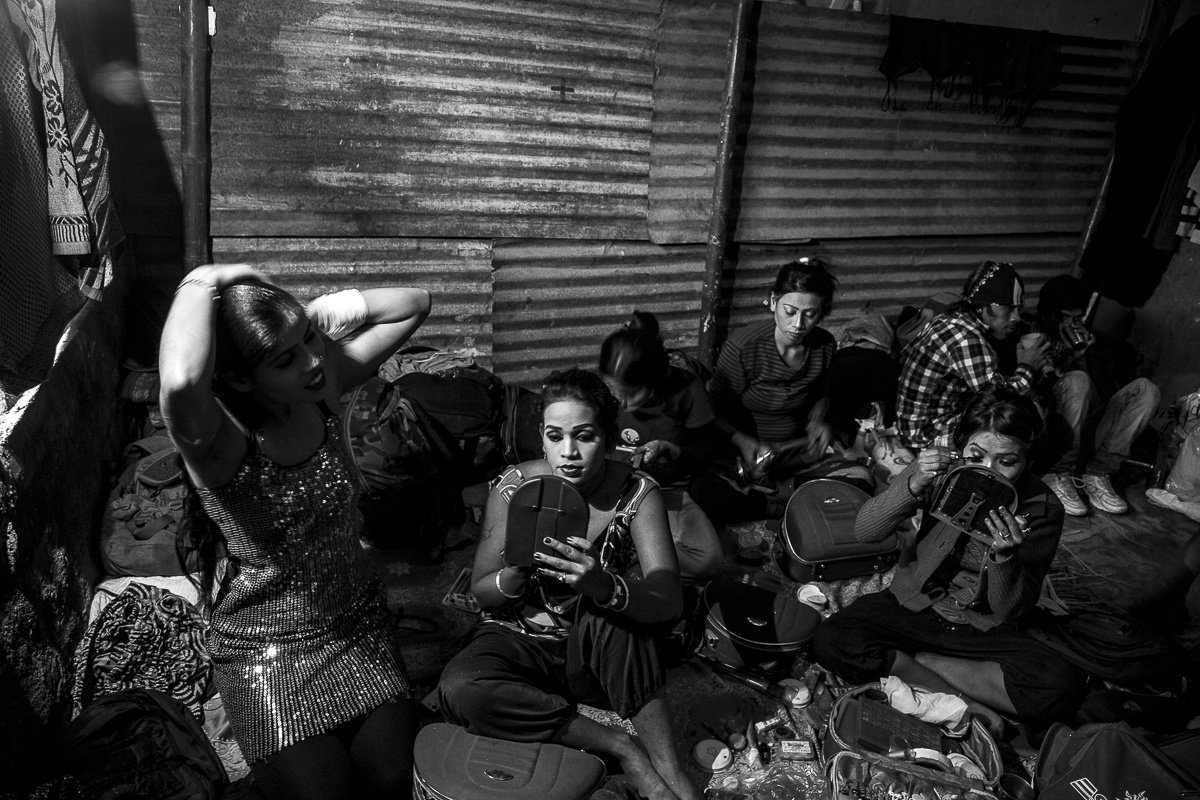 A dance troupe from Azadpur, Delhi getting ready for their ensemble where they enact religious and mythological dance remixes. Some of them are makeup artists, Bhojpuri film support dancers and barbers in their other lives.