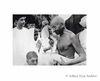Mahatma Gandhi Listening to a woman in distress at Nizamuddin railway station New Delhi G.D.Birla is on the left.1938