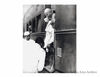 Mahatma Gandhi alighting from the train at New Delhi. He always traveled by third  class 1940s