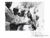 At Utmanzai (NWFP)in native village of Khan Abdul Guffar Khan (seen on left), Mahadev Desai in with Gandhi Cap 1938.