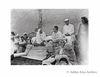 Mahatma Gandhi with  Khan Abdul Ghaffar Khan at his native village Utmanzai, seen behind is Mahadeo Desai. 1938