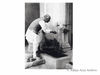 Jawaharlal Nehru washing his hands at Anand Bhavan, Allahabad after lunch at a Congress Working Committee meeting.1938