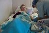 Oksana, 43, reçois les soins dans l'ancien hôpital numéro 11, le centre de sclérose en plaque, a Moscou, le 18 décembre, 2014. Elle vient seulement d'être diagnostiquée avec la sclérose en plaque après avoir 23 ans sans savoir ce qu'elle avait. L'hôpital numéro 11 est endroit unique pour les patients comme Oksana. Le personnel est très a l'écoute des malades.